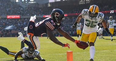 Bears running back Tarik Cohen (29) scores a touchdown against the Packers.
