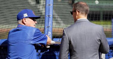 Cubs manager Joe Maddon, left, and president of baseball operations Theo Epstein