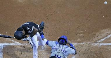 White Sox shortstop Tim Anderson recoils after being hit by a pitch by Royals right-hander Glenn Sparkman.
