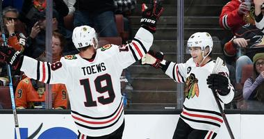 Blackhawks winger Patrick Kane (right) celebrates his game-winning goal with center Jonathan Toews (19).