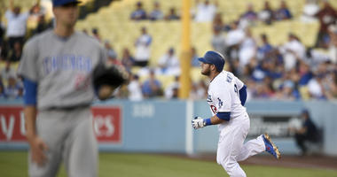 The Dodgers' Max Muncy runs out his home run off Cubs right-hander Kyle Hendricks.