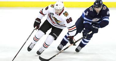 Blackhawks forward Patrick Kane, left