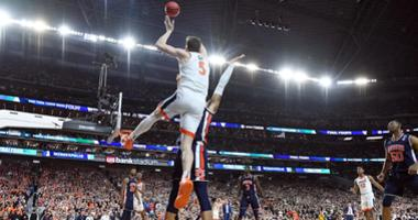 Virginia guard Kyle Guy is fouled with 0.6 seconds left in his team's win in the Final Four.