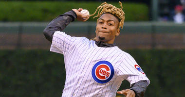 Buster Skrine throws out the ceremonial first pitch at Wrigley Field