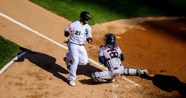 stros catcher Robinson Chirinos (28) tags out White Sox catcher Welington Castillo (21) at home plate.