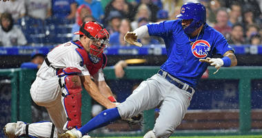 Cubs outfielder Nick Castellanos slides safely into home plate against the Phillies.