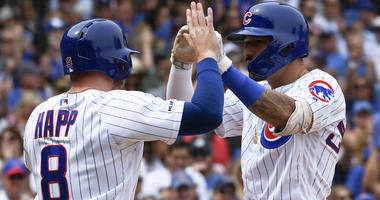 Nick Castellanos, right, is congratulated by Cubs teammate Ian Happ after homering.