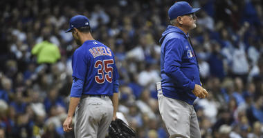 Cubs manager Joe Maddon, right, pulls left-hander Cole Hamels from the game.