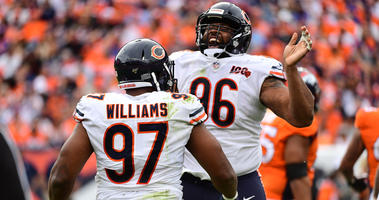 Bears defensive linemen Nick Williams, left, and Akiem Hicks celebrate.