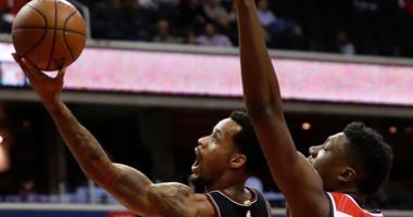 Bulls guard Walt Lemon Jr. (25) shoots the ball as Wizards center Thomas Bryant (13) defends.