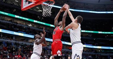 Bulls center Wendell Carter Jr. (34) goes to the basket against Nuggets center Nikola Jokic.