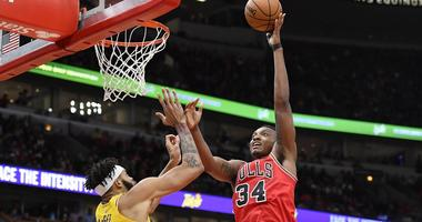 Bulls center Wendell Carter Jr. (34) shoots against Lakers center JaVale McGee.