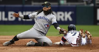 Blue Jays shortstop Freddy Galvis (16) tags out White Sox shortstop Tim Anderson (7).