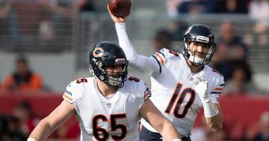 Bears quarterback Mitchell Trubisky (10) throws a pass behind center Cody Whitehair (65).