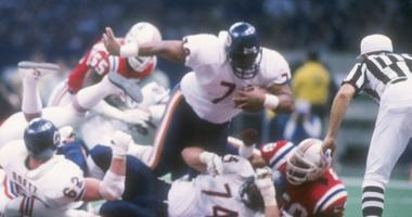 """Bears defensive tackle William """"Refrigerator"""" Perry scores on a touchdown run in Super Bowl XX."""