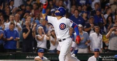 Cubs catcher Willson Contreras rounds the bases after homering.