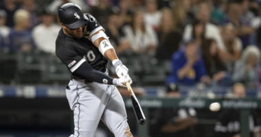 White Sox third baseman Yoan Moncada hits an RBI triple against the Mariners.