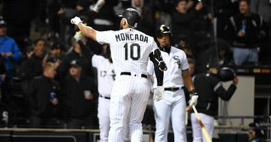 White Sox third baseman Yoan Moncada (10) reacts after hitting a home run against the Royals.