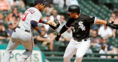 Twins shortstop Jorge Polanco (11) tags out White Sox second baseman Yolmer Sanchez (5) in a rundown.