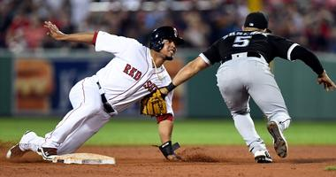 Red Sox third baseman Marco Hernandez (40) slides safely into second base as White Sox second baseman Yolmer Sanchez (5) attempts a tag.
