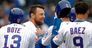 The Cubs celebrate a walk-off single by Ben Zobrist, second from left.