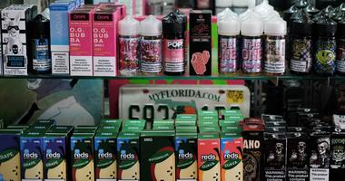 Vaping products, including flavored vape liquids and pods, are displayed at Gotham Vape.