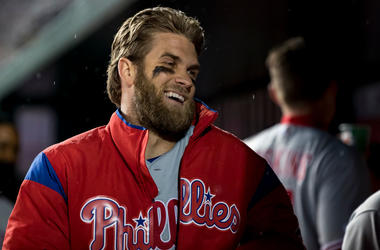 Bryce Harper #3 of the Philadelphia Phillies reacts in the dugout after Maikel Franco hit a home run in the second inning against the Washington Nationals at Nationals Park on April 2, 2019 in Washington, DC.