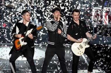 Nick Jonas, Joe Jonas and Kevin Jonas of the Jonas Brothers perform onstage