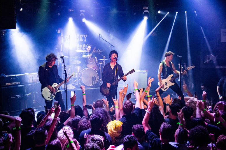 """Jason White, Tré Cool, Billie Joe Armstrong and Mike Dirnt of Green Day perform during the """"Hella Mega Tour"""" announcement show at Whisky a Go Go"""