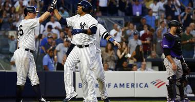 Encarnacion, ex-Rockies help Yankees Defeat Colorado 8-2