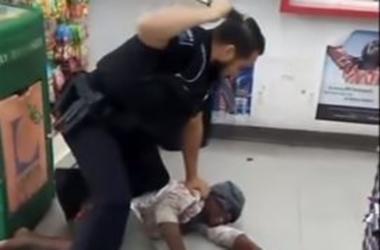 Phillip Larscheid is seen in video beating Katie McCrary with his police baton