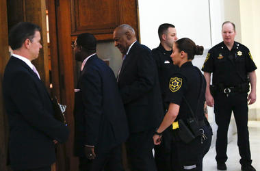 Bill Cosby is lead from the courtroom after being found guilty in sexual assault trial