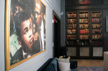 A painting of Muhammad Ali and Malcolm X inside Cam Newton's Fellaship lounge in Atlanta