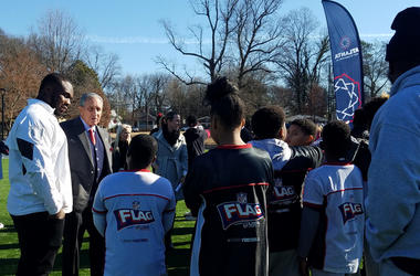 Grady Jarrett and Falcons Owner Arthur Blank chat with students at the newly renovated John F. Kennedy Park in Vine City.
