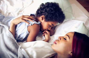 A mother sleeps next to her child