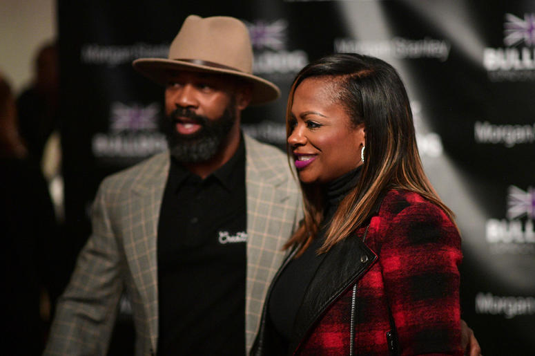 """Kandi Burruss and Trap Music Museum curator D.L. Warfield at Warfield's """"My Favorite Things"""" art exhibit on November 30, 2018, in Atlanta."""