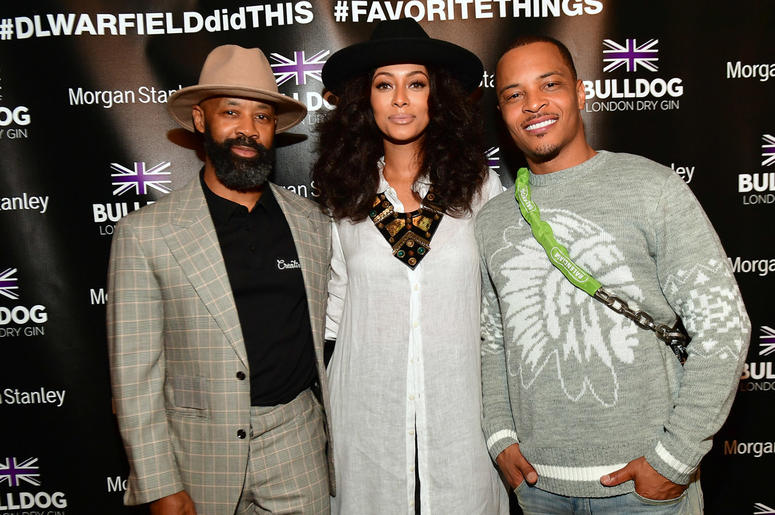 """T.I., Keri Hilson, and Trap Music Museum curator D.L. Warfield at Warfield's """"My Favorite Things"""" art exhibit on November 30, 2018, in Atlanta."""