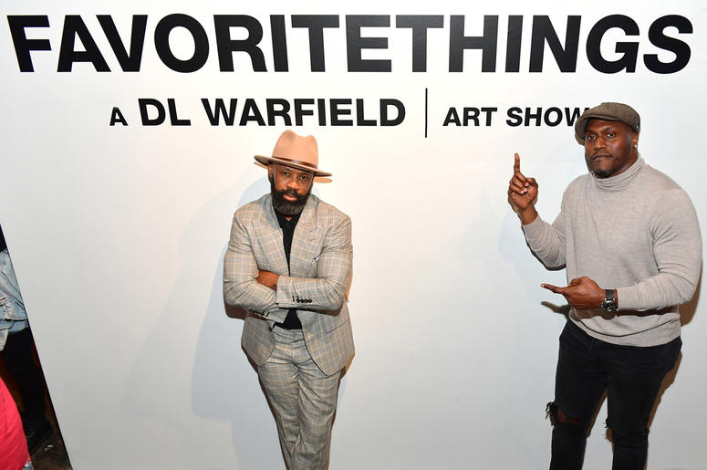 """NFL Hall of Fame nominee Takeo Spikes hosted D.L. Warfield's """"My Favorite Things"""" art exhibit on November 30, 2018, in Atlanta."""
