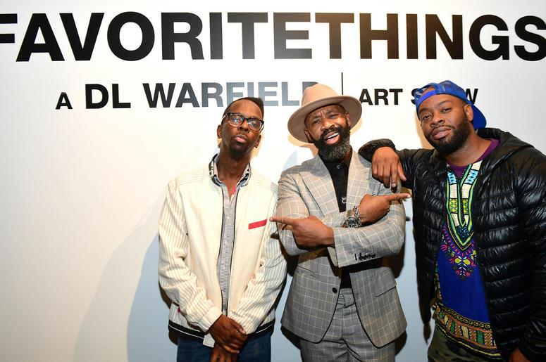 "Atlanta artists Fahamu Pecou and Fabian Williams with D.L. Warfield at his ""My Favorite Things"" Art Exhibit in Atlanta; November 30, 2018."