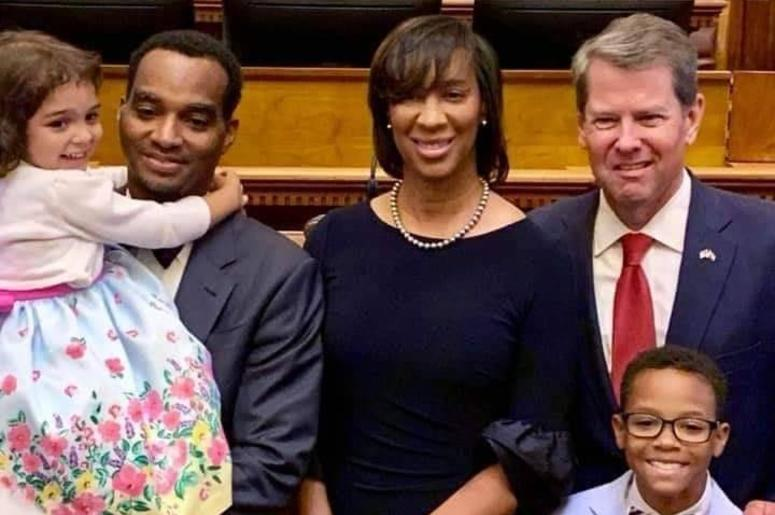 Gov. Kemp is shown with Shondeana Morris and family. He placed her on the Superior Court bench in DeKalb County.