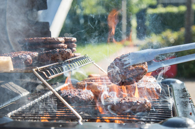 A grill with flame-broiling meats