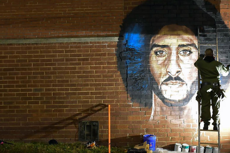 """Artist Fabian Williams paints a new Colin Kaepernick mural in response to his """"Kaeplanta"""" mural being demolished on Feb 1 before Super Bowl 53"""