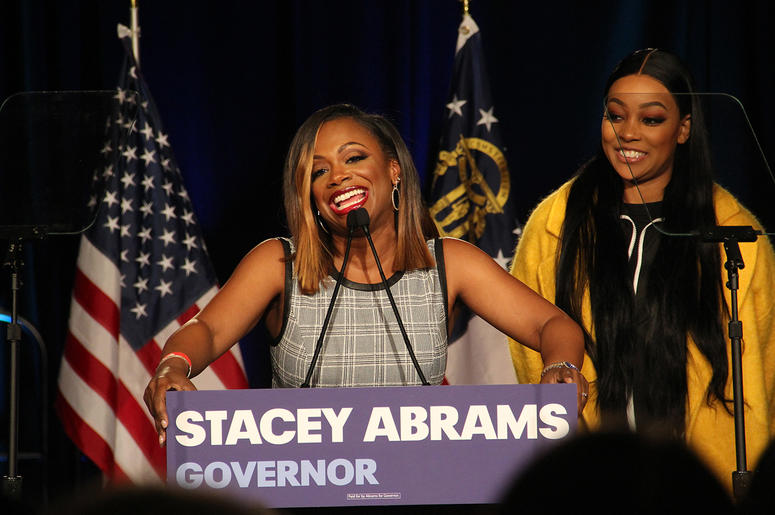 Kandi Burruss speaks at Stacey Abrams' election night campaign party