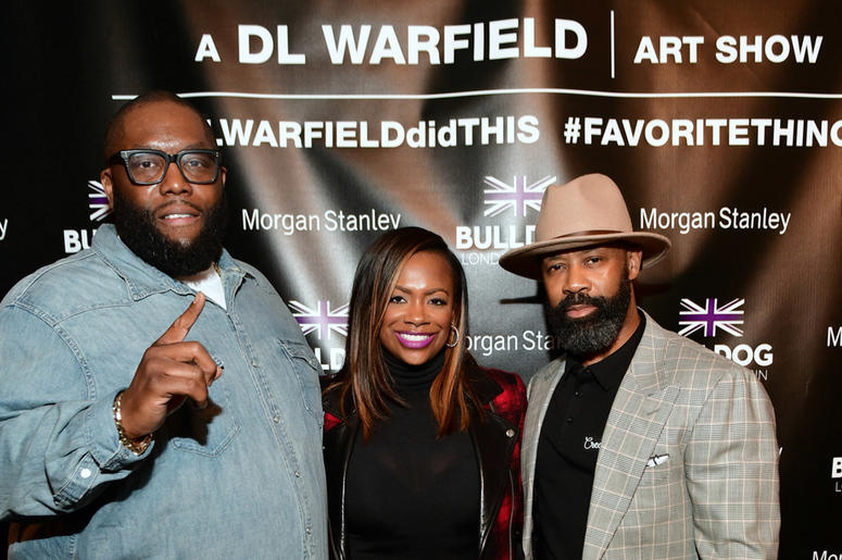 "Killer Mike and Kandi Burrus pose with D.L. Warfield at his ""My Favorite Things"" Art Exhibit in Atlanta; November 30, 2018."