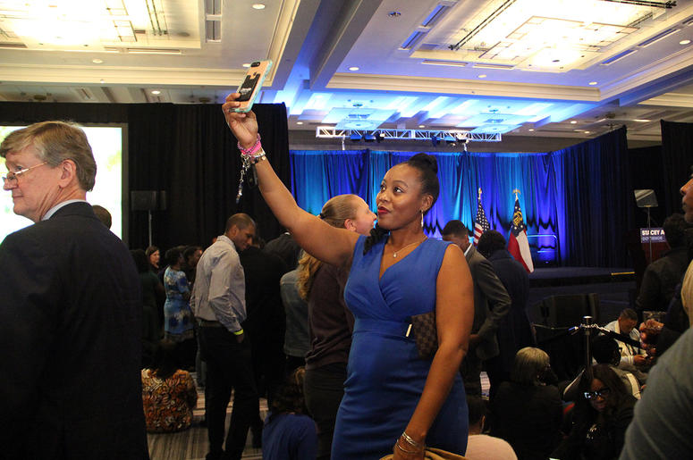A lady takes a selfie at Stacey Abrams' election night campaign party
