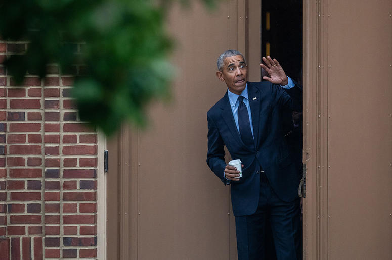 Former president Barack Obama greets students gathered outside the Foellinger Auditorium at the University of Illinois at Urbana-Champaign after his speech in Urbana, Ill., on Friday, Sept. 7, 2018.