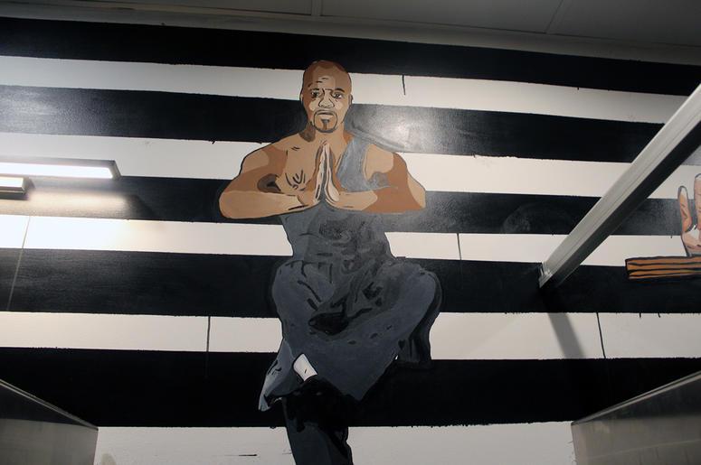 A mural of Jermaine Dupri in the men's restroom at Slim & Husky's in Atlanta