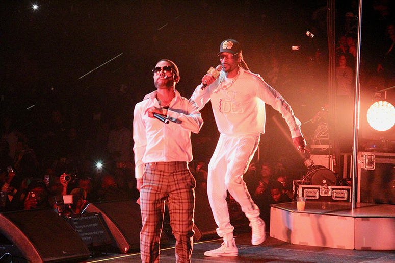 Snoop Dogg and Lil Duval perform at Atlanta's State Farm Arena during the Puff Puff Pass Tour
