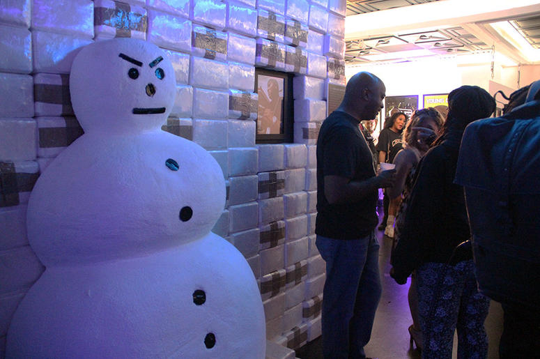 Former Atlanta City Council member Kwanza Hall stands near Young Jeezy's exhibit at T.I.'s Trap Music Museum