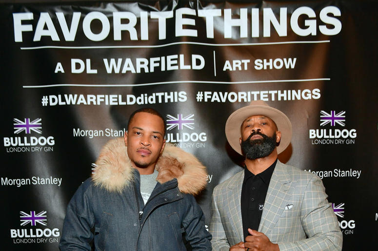 """T.I. with Trap Music Museum curator D.L. Warfield during his """"My Favorite Things"""" art exhibit on November 30, 2018, in Atlanta."""